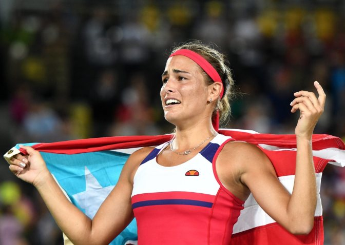 Tennis Star Puig wins Puerto Rico's 1st Olympic gold ever!